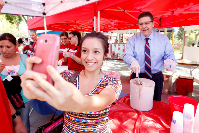 2014 - Joe Castro serves smiles, selfies and ice cream from Fresno State's own farm where students milk the cows and process it into a variety of dairy products.