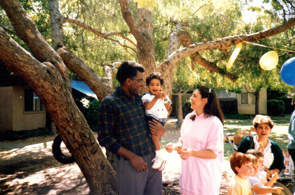 Jonathan Jansen and wife Grace (center) hold a birthday party for son Mikhail at their Stanford graduate residence, 141B Escondido Village.