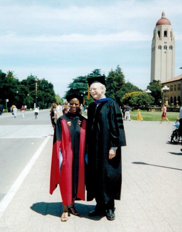 Carla Pugh with Decker Walker, professor of education, during Stanford's 2001 commencement.