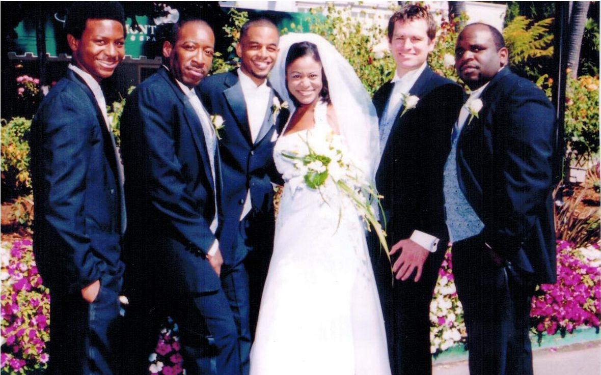 Carla Pugh and her husband Joseph Towles (third from left) on their wedding day, April 16, 2003.