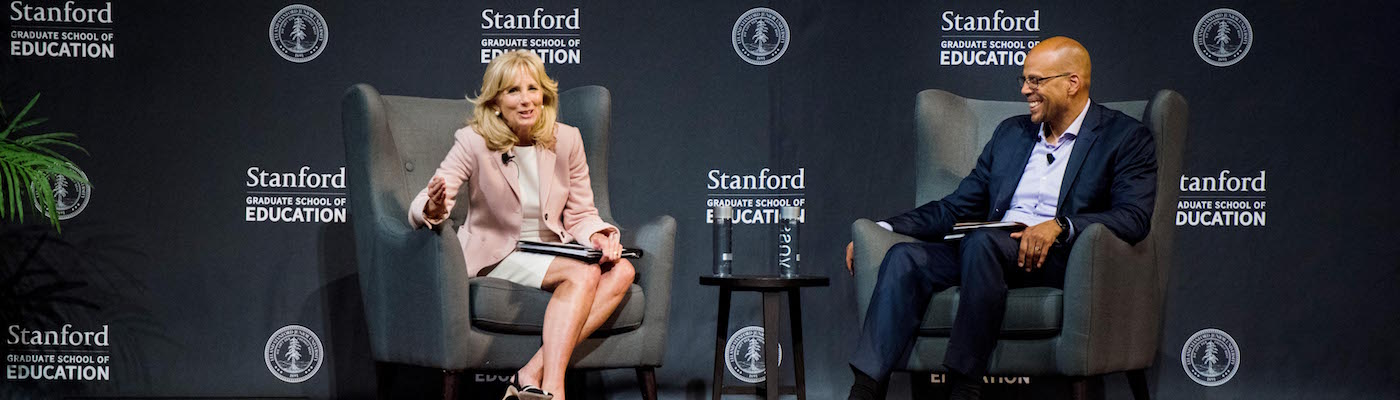 Photo of Dr. Jill Biden and Jim Shelton sitting on a stage