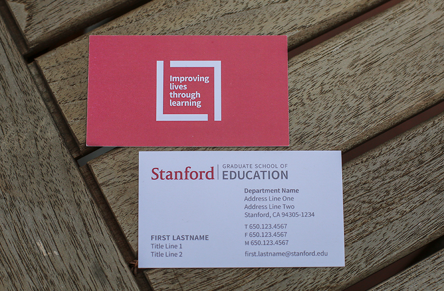 Photo of Stanford Graduate of Education business cards with Improving lives through learning signature on back