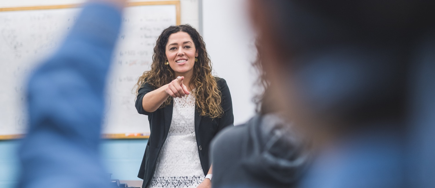 picture of teacher in classroom calling on student (photo credit: iStock/FatCamera)
