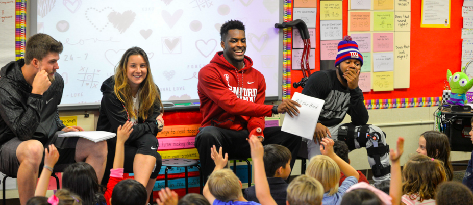 Stanford students read their children's book to kids at a local elementary school. Photo by Rod Searcey