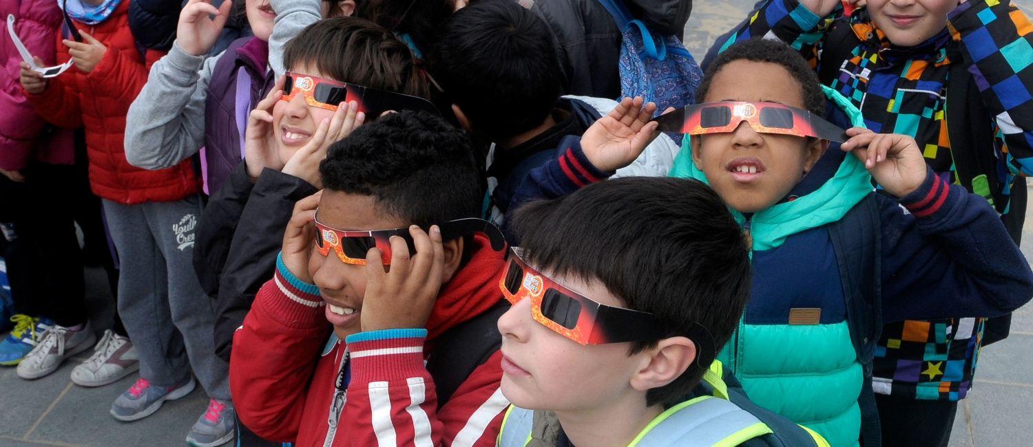 Picture of kids looking at a solar eclipse