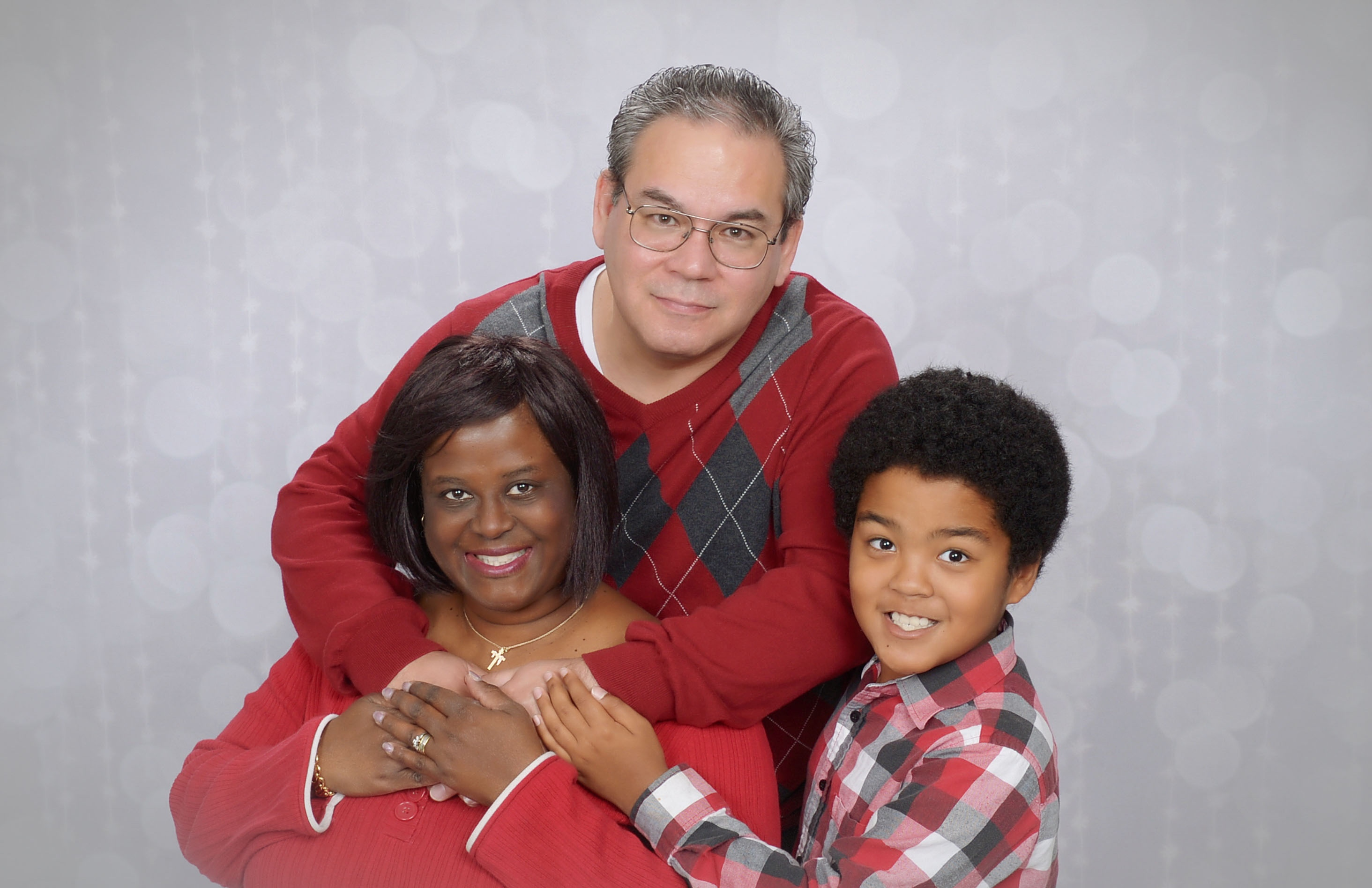A family portrait of Biddle with her husband, Chris, and son, Emmanuel.