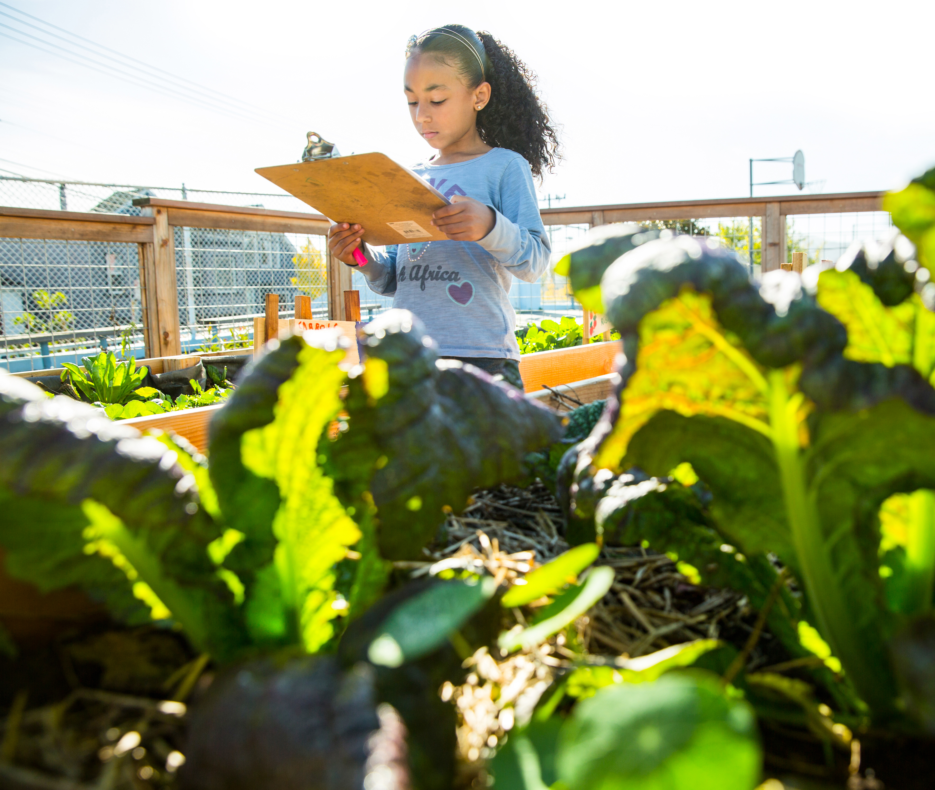 Photo of young girl in garden by Education Outside