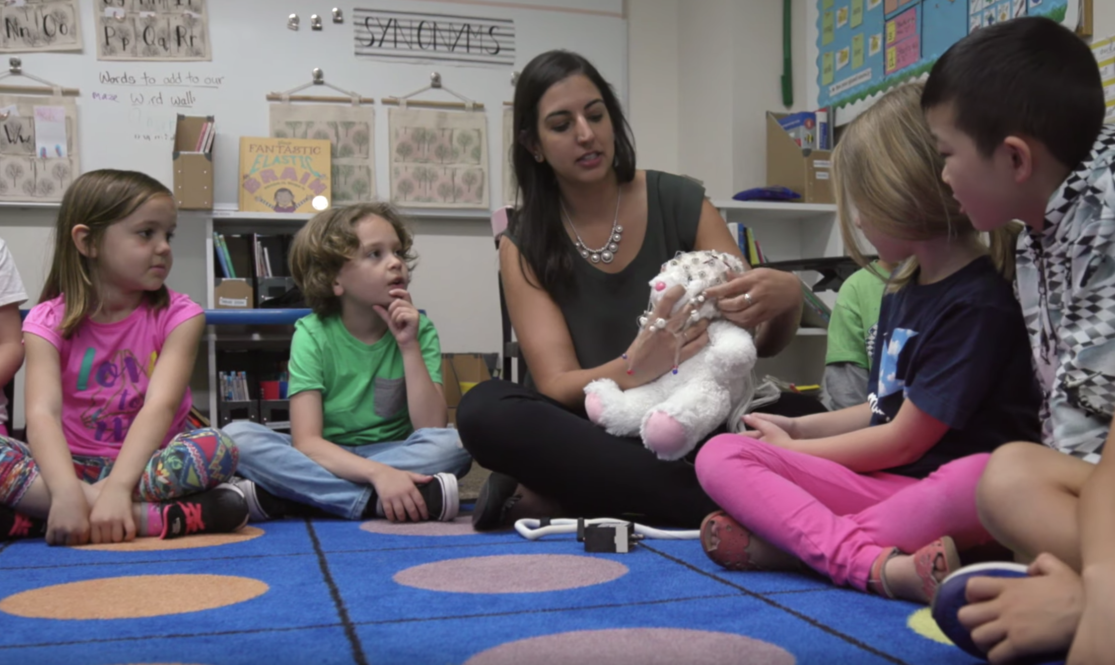 Picture of Elizabeth Toomarian teaching children about neuroscience with a stuffed bunny rabbit.