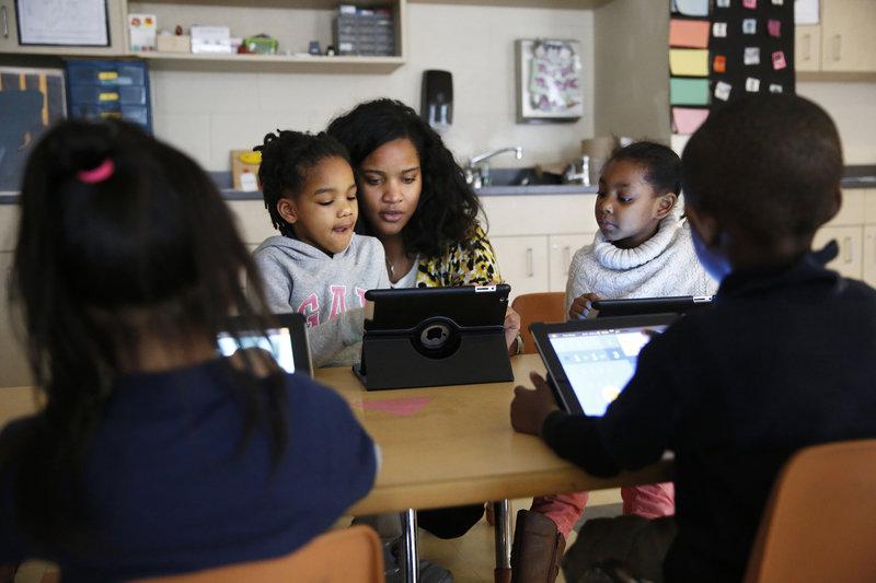 Kindergarten teacher Marissa McGee with several students. (Photo by Elissa Nadworny/NPR)