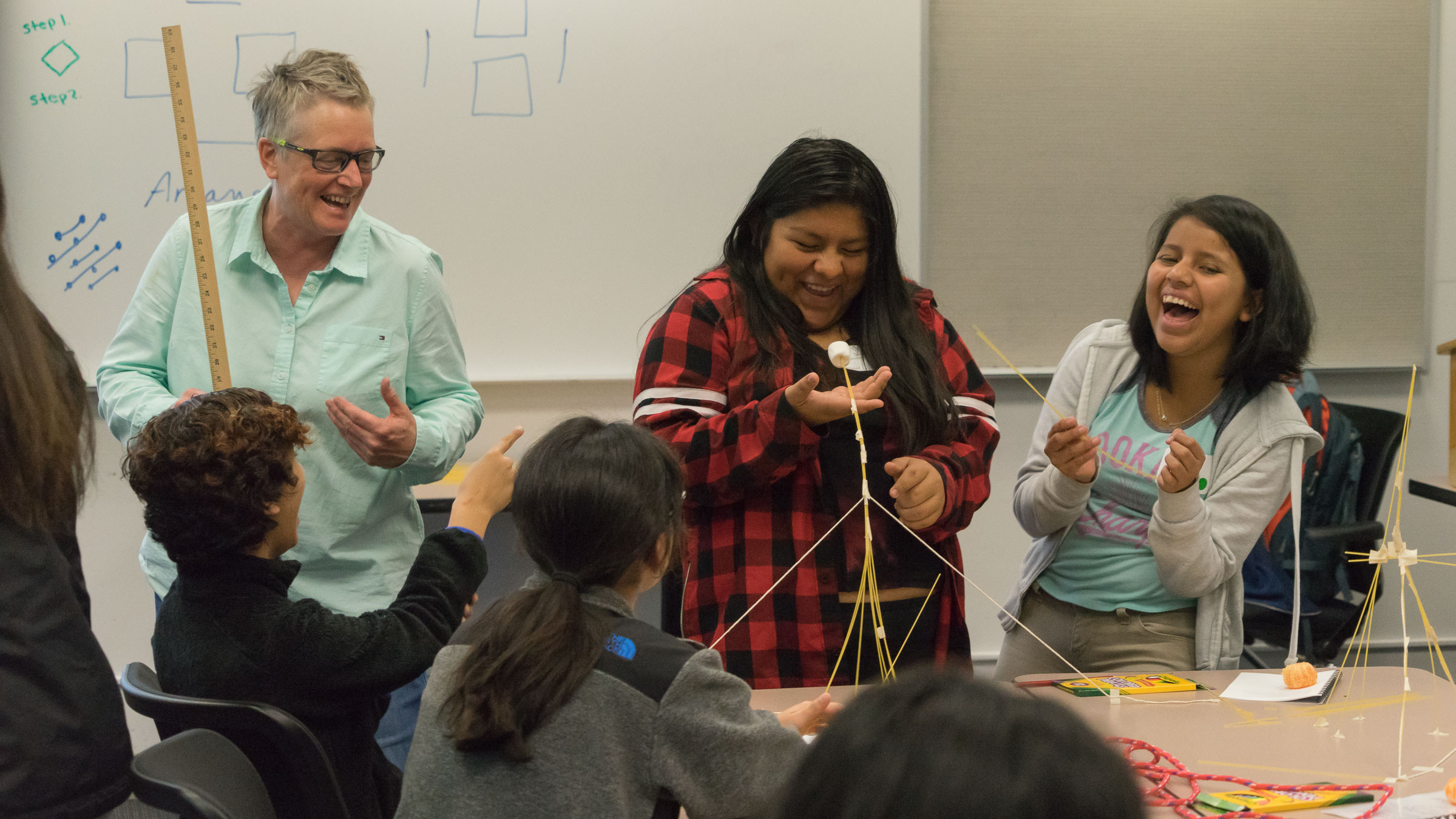 Cathy Williams, left, works with students during a Youcubed math workshop for girls at Stanford. (Photo: Marc Franklin)