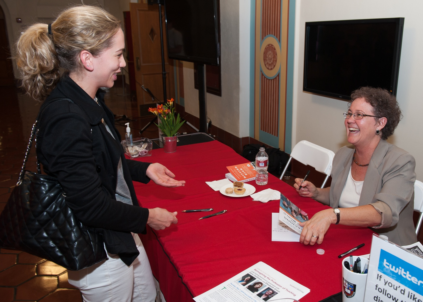 """Linda Darling-Hammond signs copies of her book, """"Teaching in the Flat World"""" at the 2015 Cubberley Lecture (Photo: Steve Castillo)"""
