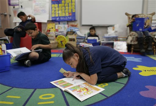 Stanford, EPI study finds academic gains for minority students but English learners still lag behind. (AP Photo/Julie Jacobson)