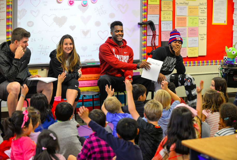Stanford students read their children's book to 1st graders (Photo: Rod Searcey)