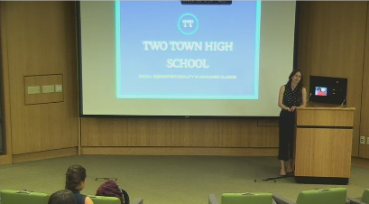 Screencap of Stefanie Tate presenting.