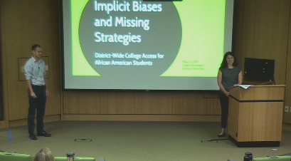 Screencap of Carley Davenport and Zachary Marx-Kuo presenting.