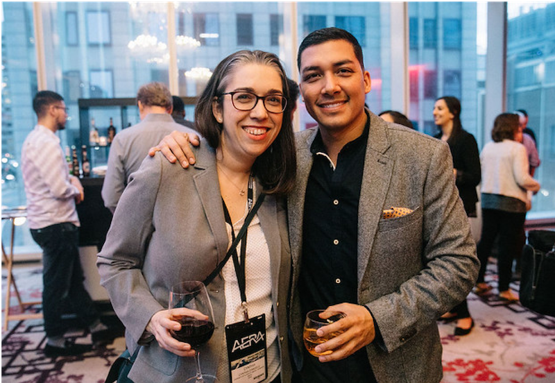 Photo of a woman and a man at a cocktail event.