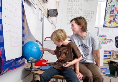 Tyler and his mother Susan Kramer in a classroom at Ohlone Elementary School in Palo Alto, Calif. (Photo by Norbert von der Groeben)
