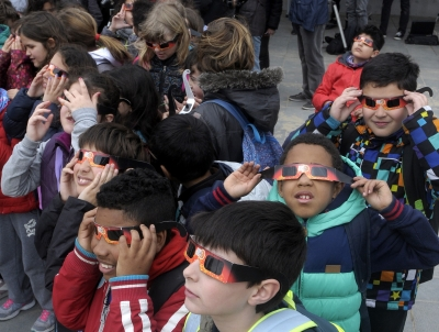 Picture of children looking at an eclipse in Spain. (Getty