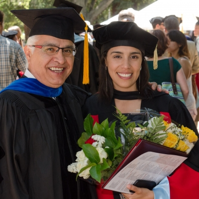 Brenda Jarillo Rabling celebrates her PhD with advisor Amado Padilla. (Photo by Chris Wesselman)