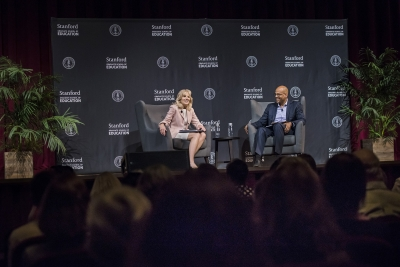 Jill Biden and Jim Shelton have a conversation. Picture by Ryan Zhang.