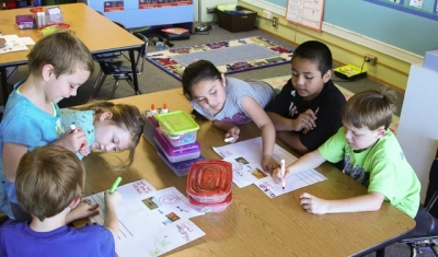 First graders in a dual language program in Corvallis, Ore. work on a poster project.