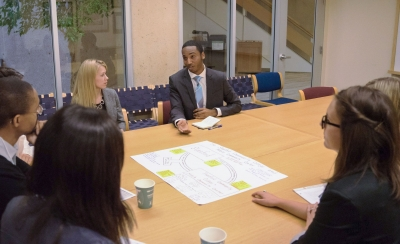 Master's students discuss their $200 million idea with Stanford alumni during the POLS Challenge (Photo: Marc Franklin)