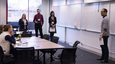 Master's students present their proposal to alumni panelists during the POLS Challenge. (Photo: Marc Franklin)