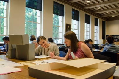 TeachersEstherMansdorfandErinWilson examine source materials at the Hoover Institution Library and Archives as part of a pr