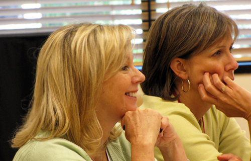 Two female adults during a meeting.
