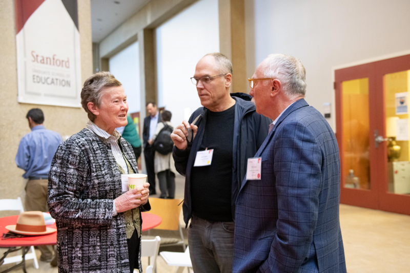 Helen Quinn (left) chaired the National Academy of Sciences Committee that produced the basis for the Next Generation Science Standards. Here she talks with UCLA psychology professor Jim Stigler (center) and Phil Daro, co-author of the Common Core math standards.