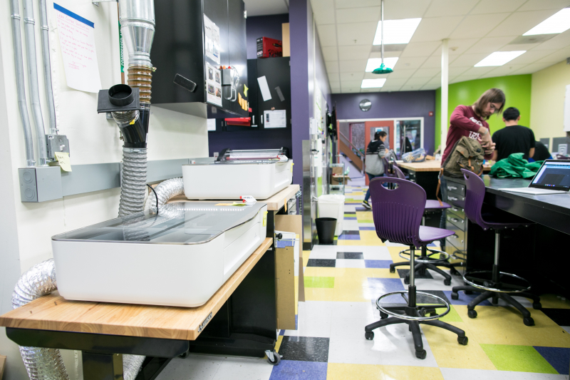 Two laser cutters (foreground) are affectionately named Montessori and Freire after the renowned educational theorists.