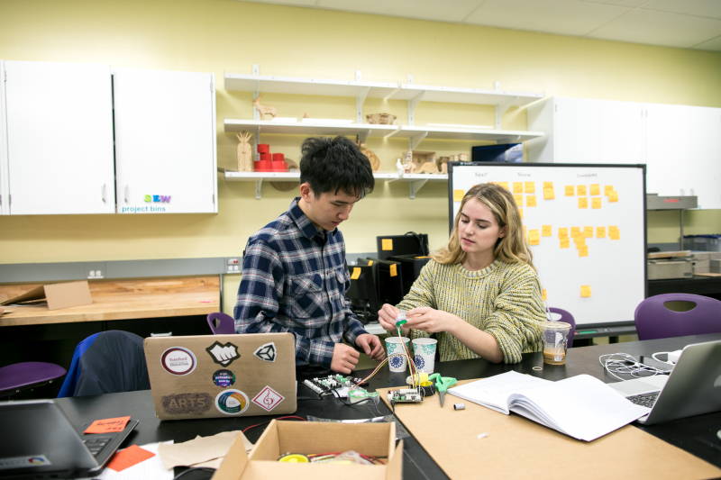 Andy Jiang, a master's student in the GSE's Learning, Design and Technology program, and Taylor Hendrickson, a senior majoring in English, work with an electronic circuit-building kit.