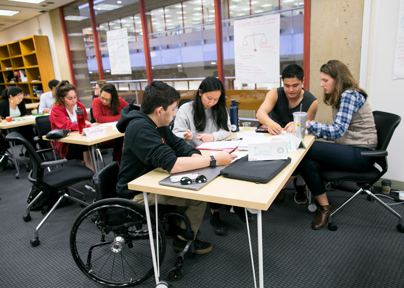 Students working around a table.