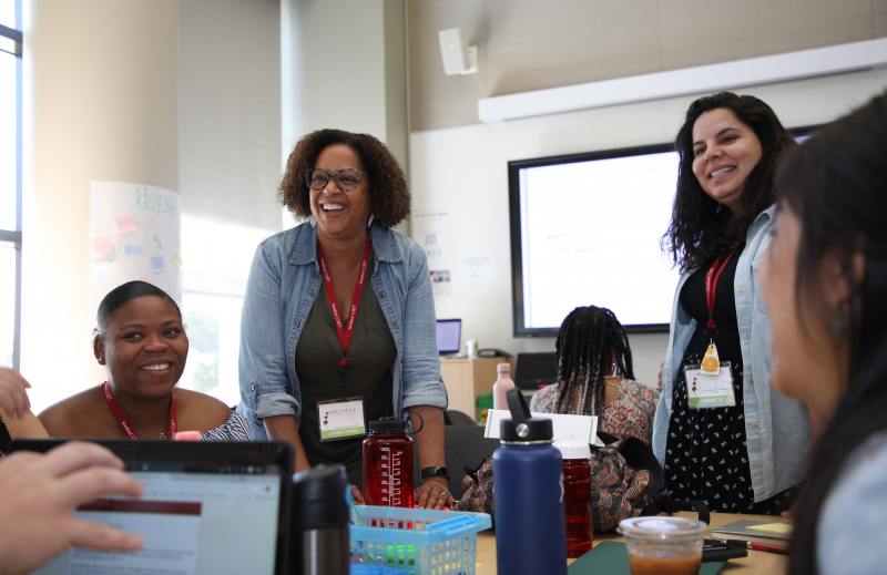 Teachers smiling across the table