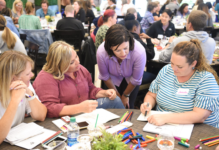 Photo of Jo Boaler working with a group of participants.