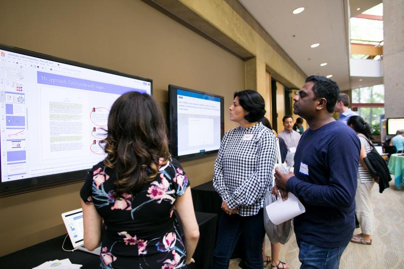 Julia Rubin (left) shares Carlo, a web-based tool that helps teachers provide feedback on student writing.