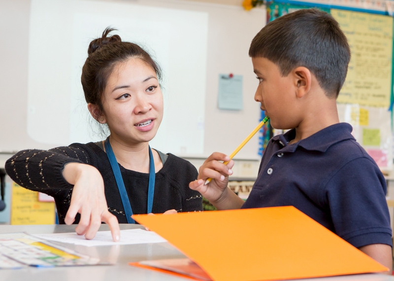 STEP student working with a child on an assignment