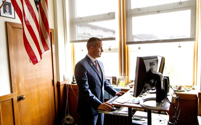 Barnaby Payne works at his desk at Abraham Lincoln High School (Photo by Norbert von der Groeben)
