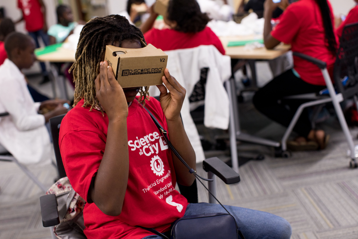 Photo of kids using cardboard VR viewers