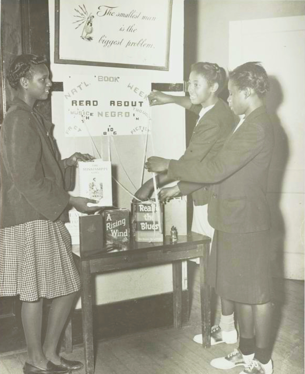Photo of girls making a display for National Book Week