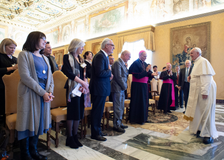 Photo of the pope greeting researchers