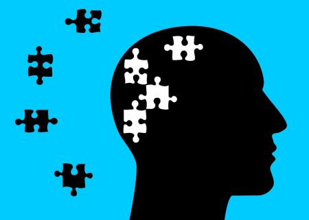 Illustration of the profile of a head with puzzle pieces missing and lost.
