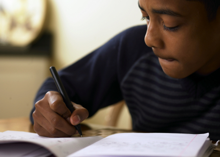 Photo of boy doing schoolwork at home
