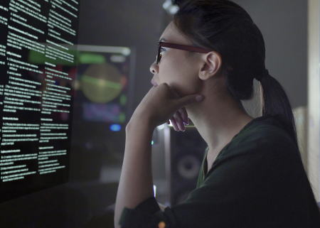 Photo of student examining data on a screen