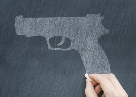 Illustration of a gun being drawn on a chalkboard