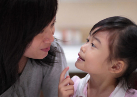 Photo of a woman talking to a kid