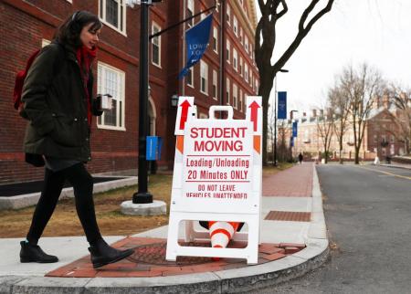 Student walking on Harvard campus