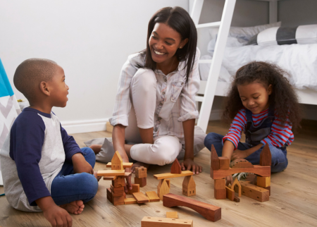 Mother playing blocks with her kids