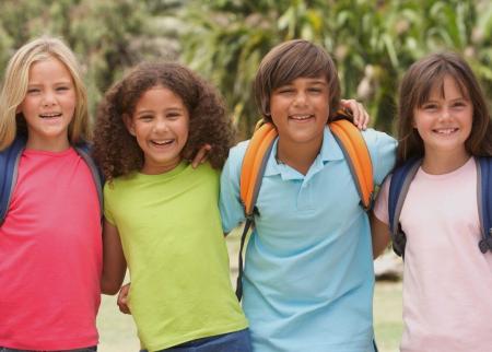 Four kids posing outside