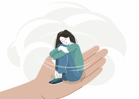 An illustration of a sorrowful young person in the palm of a hand
